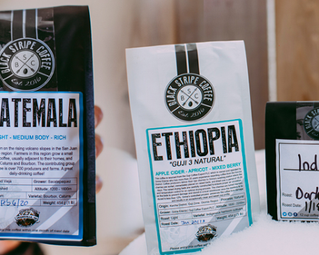 Why Custom Stickers are Important as Label Per Black Stripe Coffee